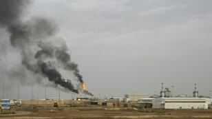 Smoke billows from Iraq's Majnoon oil field near the southern city of Basra on March 25, 2019
