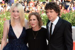 Jesse Eisenberg with costar Dakota Fanning (left) and director Kelly Reichardt (centre) on the Venice red carpet.