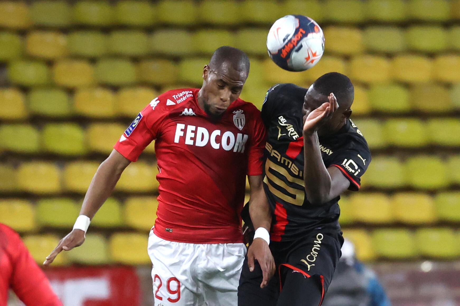 Monegasque defender Djibril Sidibé, wrestling with Rennes striker Serhou Guirassy, during their Ligue 1 match, on May 16, 2021 at Stade Louis II
