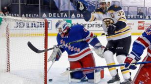 Boston Bruins captain Patrice Bergeron, 37,  celebrates the overtime goal by Brad Marchand against New York Rangers goaltender Alexandar Georgiev at Madison Square Garden  in New York