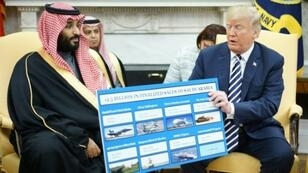 US President Donald Trump (R) is seen holding a defense sales chart with Crown Prince Mohammed bin Salman of Saudi Arabia, a country to which US lawmakers have expressed concern about selling weapons that might be used against Yemeni civilians