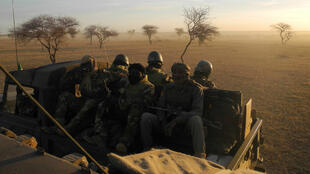 Malian soldiers, part of the joint military force the G5 Sahel, on patrol in central Mali on November 2, 2017.