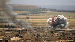 Smoke and fire rise following reported Syrian government forces' bombardment on the town of Khan Sheikhun in the southern countryside of Idlib province, on June 6, 2019