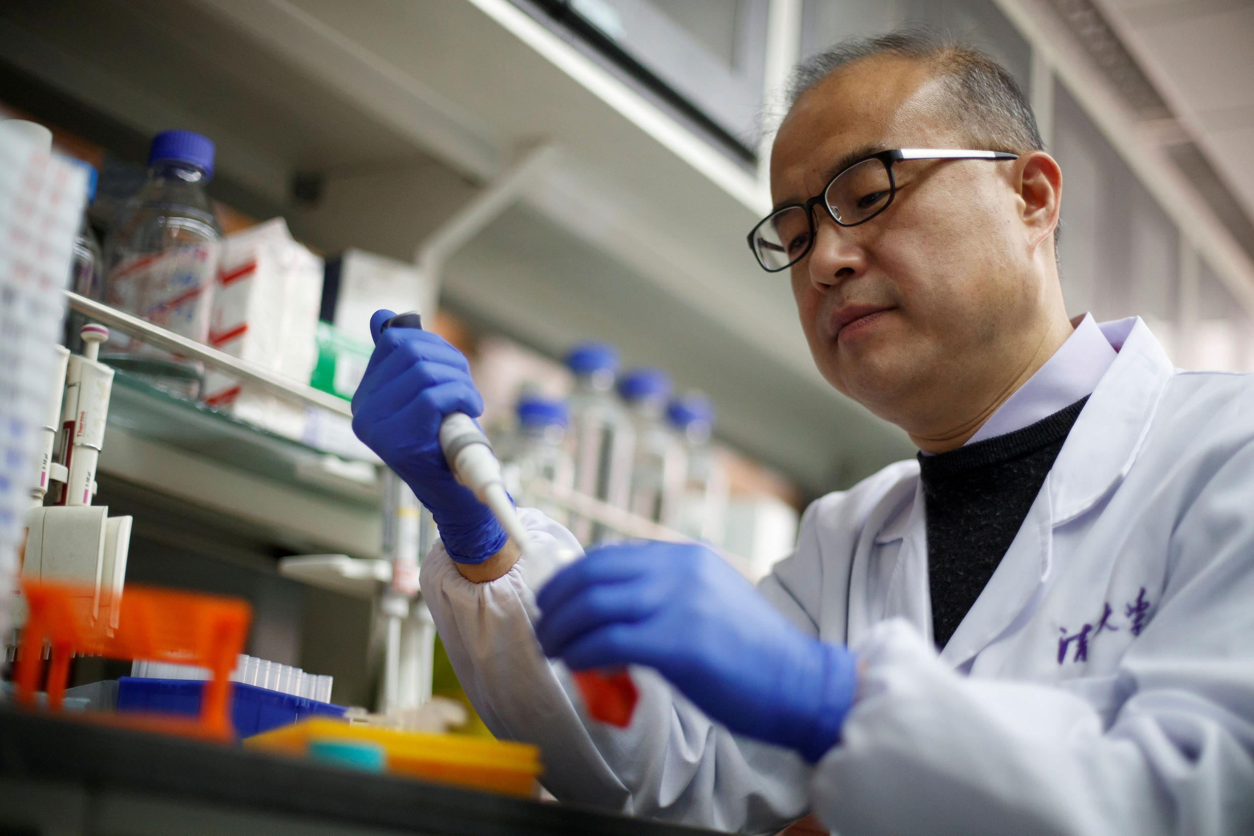 Scientist Linqi Zhang demonstrates work in his laboratory where he researches COVID-19 antibodies for use in a drug at Tsinghua University's Research Center for Public Health in Beijing on March 30, 2020.