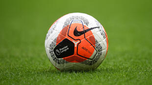 The logo of the English Premier League is pictured on a match ball