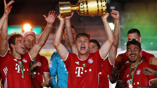 Bayern Munich midfielder Joshua Kimmich with the German Cup after a 4-2 win in Saturday's final in Berlin.