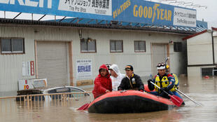 Rescue workers transport a resident in the aftermath of Typhoon Hagibis in Nagano Prefecture, Japan, on October 14, 2019.