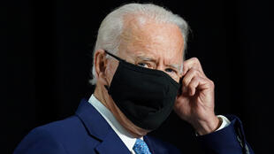 Democratic U.S. presidential candidate and former Vice President Joe Biden puts his protective face mask back on and adjusts it as he departs after speaking and answering questions from reporters during a campaign event in Wilmington, Delaware, U.S., June 30, 2020.