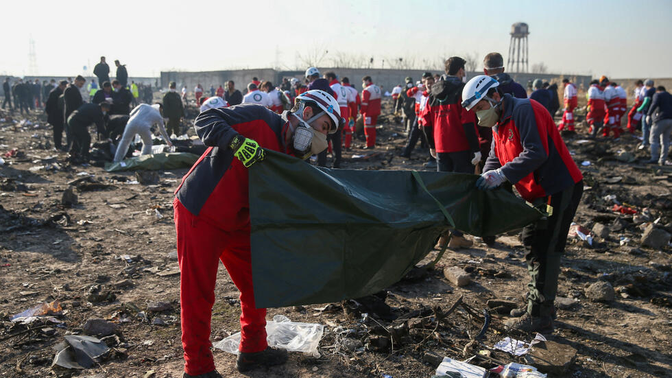 Red Crescent workers at the site of the crash on January 8, 2019.