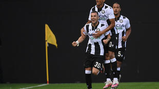 Udinese's Macedonian forward Ilija Nestorovski (L) celebrates after scoring against Juventus.