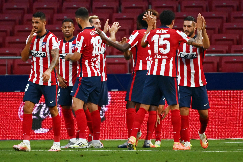 Des joueurs de l'Atlético Madrid célèbrent un but contre la Real Sociedad, le 19 juillet 2020 à Madrid.