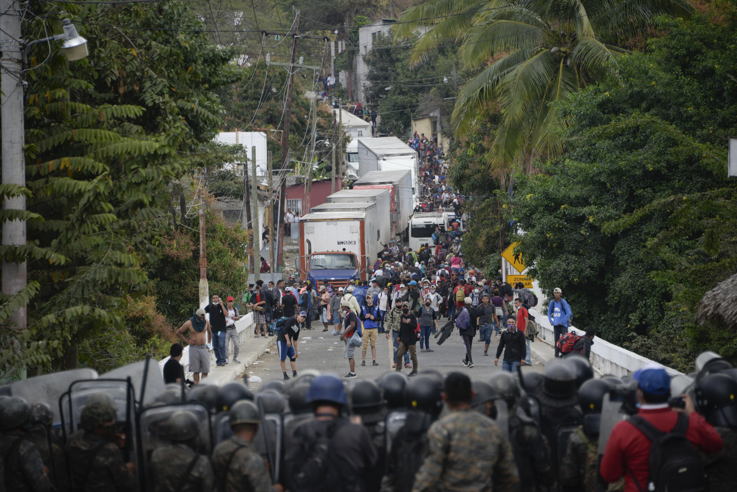 Security forces block migrants who arrived by caravan from Honduras on their way to the United States, in Vado Hondo, Guatemala, on January 18, 2021.