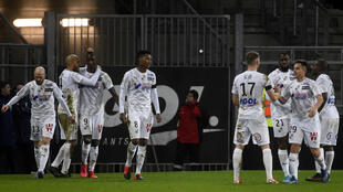 Amiens players celebrate scoring a goal in their 4-4 draw with Paris Saint-Germain in February. The club have since been condemned to relegation after the decision to end the season early due to the coronavirus