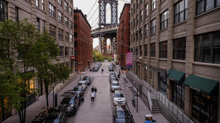 Washington Street in the DUMBO neighbourhood of Brooklyn, with the Manhattan Bridge rising in the background, pictured on May 5, 2020.