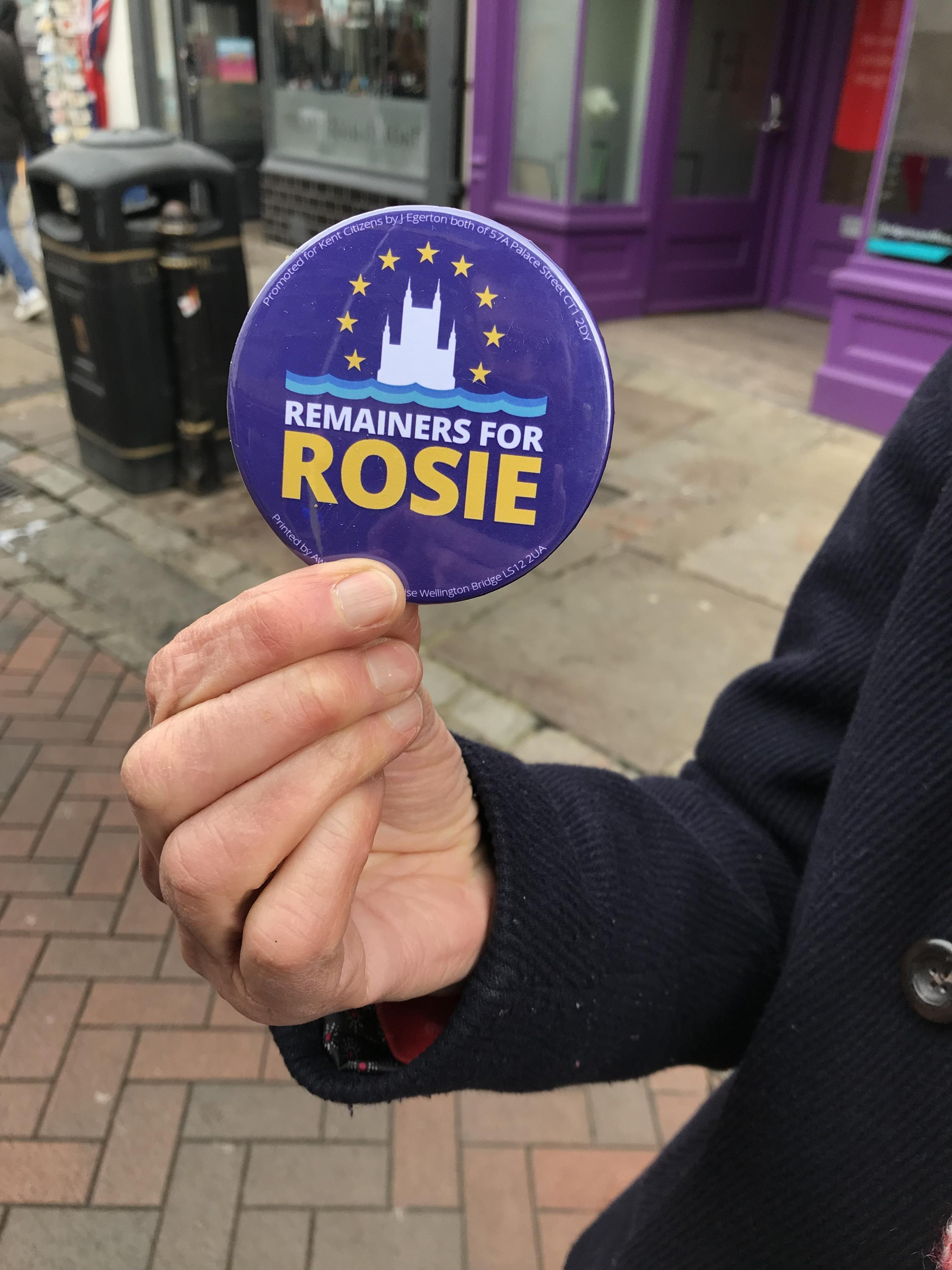 A supporter of Labour's Rosie Duffield brandishing a 'Remainers for Rosie' badge.