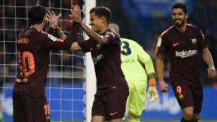 لاعبو برشلونة يحتفلون بأحد الأهداف في مرمى ديبورتيفو لاكورونيا 29 نيسان/أبريل 2018