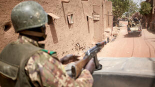 Troops of the Malian army patrol the ancient town of Djenne in central Mali on February 28, 2020. A week earlier Mali's Prime Minister announced the dismantling of the security checkpoints organized by the traditional militia hunters Dan Na Ambassagou from Dogon country.