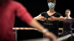 Dancers in masks rehearse at the Capitole ballet in Toulouse, France