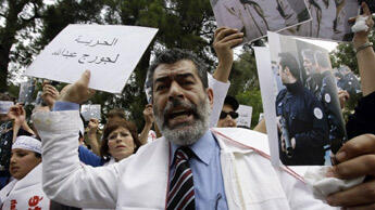 Maurice, Georges Ibrahim Abdallah's brother, protested in front of the French embassy in Lebanon in April 2010. (AFP)