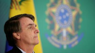 Le président brésilien Jair Bolsonaro lors d'un point de presse aux côtés du chef de l'opposition vénézuélienne Juan Guaido après une réunion à Brasilia, le 28 février 2019.