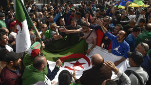 Algerian protesters gathered during a weekly anti-government demonstration in the capital Algiers on March 13 before the coronavirus outbreak halted such rallies