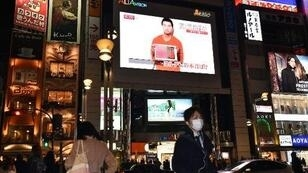 A screen in Tokyo displays a news reports about hostage Kenji Goto.