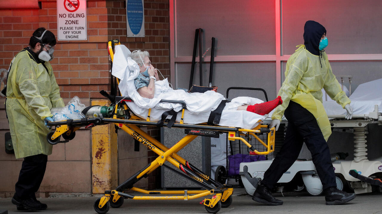 Paramedics bring a patient into the emergency center at Maimonides Medical Center during the outbreak of the coronavirus disease (COVID19) in the Brooklyn borough of New York, U.S., April 14, 2020.