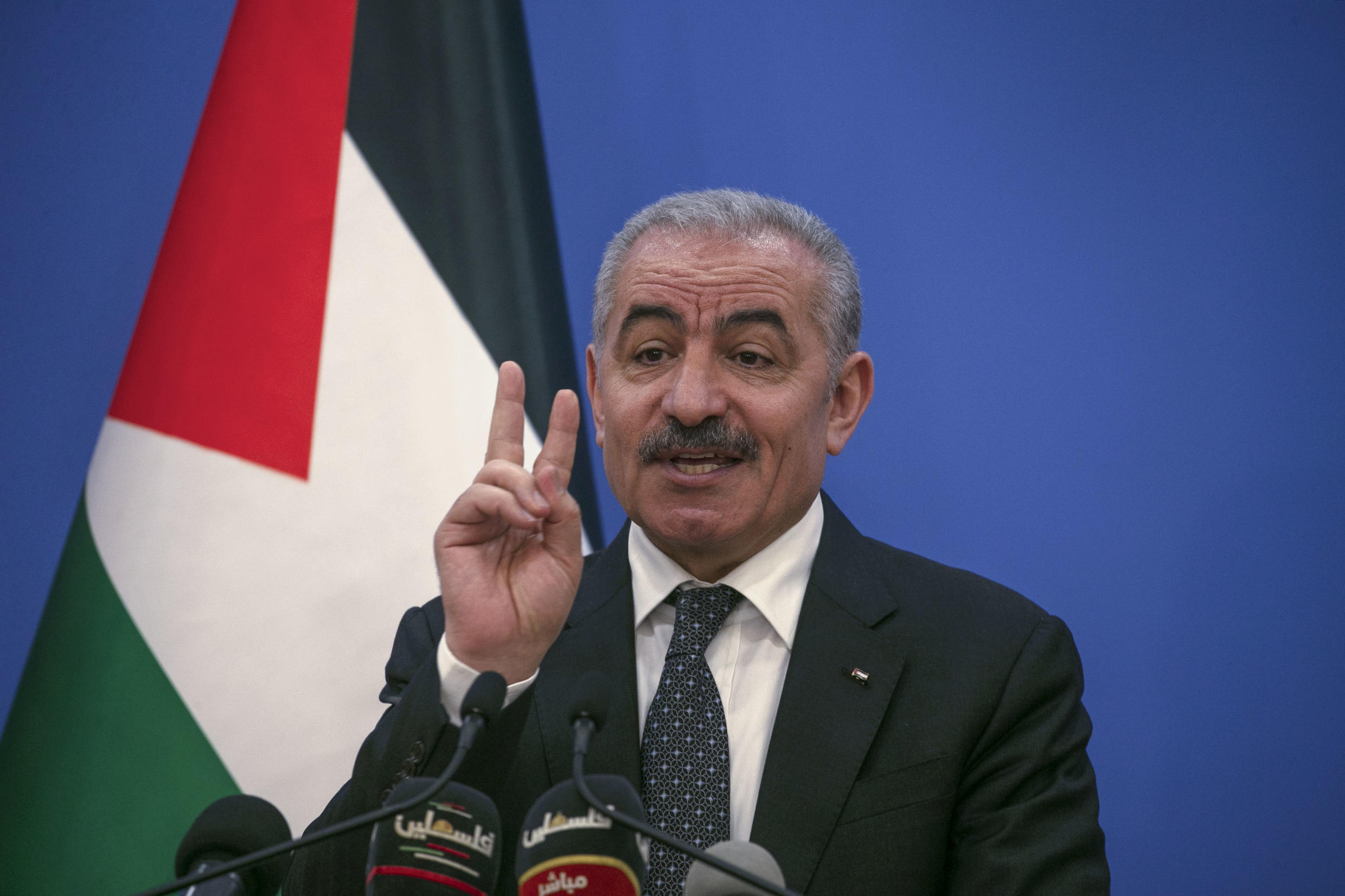 Palestinian Prime Minister Mohammad Shtayyeh gestures as he talks to reporters during a press conference in Ramallah on May 5, 2020.