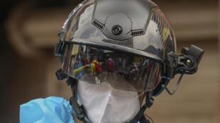 "A volunteer health worker from the Indian NGO Bharatiya Jain Sanghatana wears a ""smart helmet"" to speed up coronavirus screenings in Mumbai's slums"