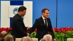 الرئيسان الفرنسي إيمانويل ماكرون والصيني شي جينبينغ