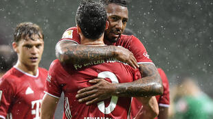 Goalscorer Robert Lewandowski is hugged by Jerome Boateng during Tuesday's 1-0 win at Werder Bremen
