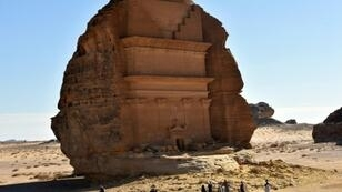 The Qasr al-Farid tomb (The Lonely Castle) carved into rose-coloured sandstone in Madain Saleh, a UNESCO World Heritage site in Saudi Arabia's Al-Ula governorate
