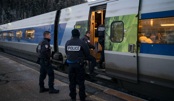 Piero Cruciatti, AFP | French police officers board a Milan-Paris TGV train at the Bardonecchia train station in this January 12, 2018, file photo.