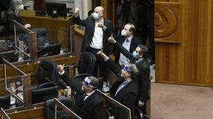 Senators in Chile give the thumbs up as they vote on pension reform