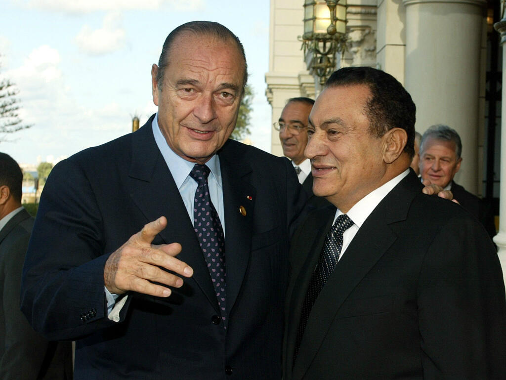 French President Jacques Chirac and Mubarak on October 16, 2002, in Alexandria, Egypt.