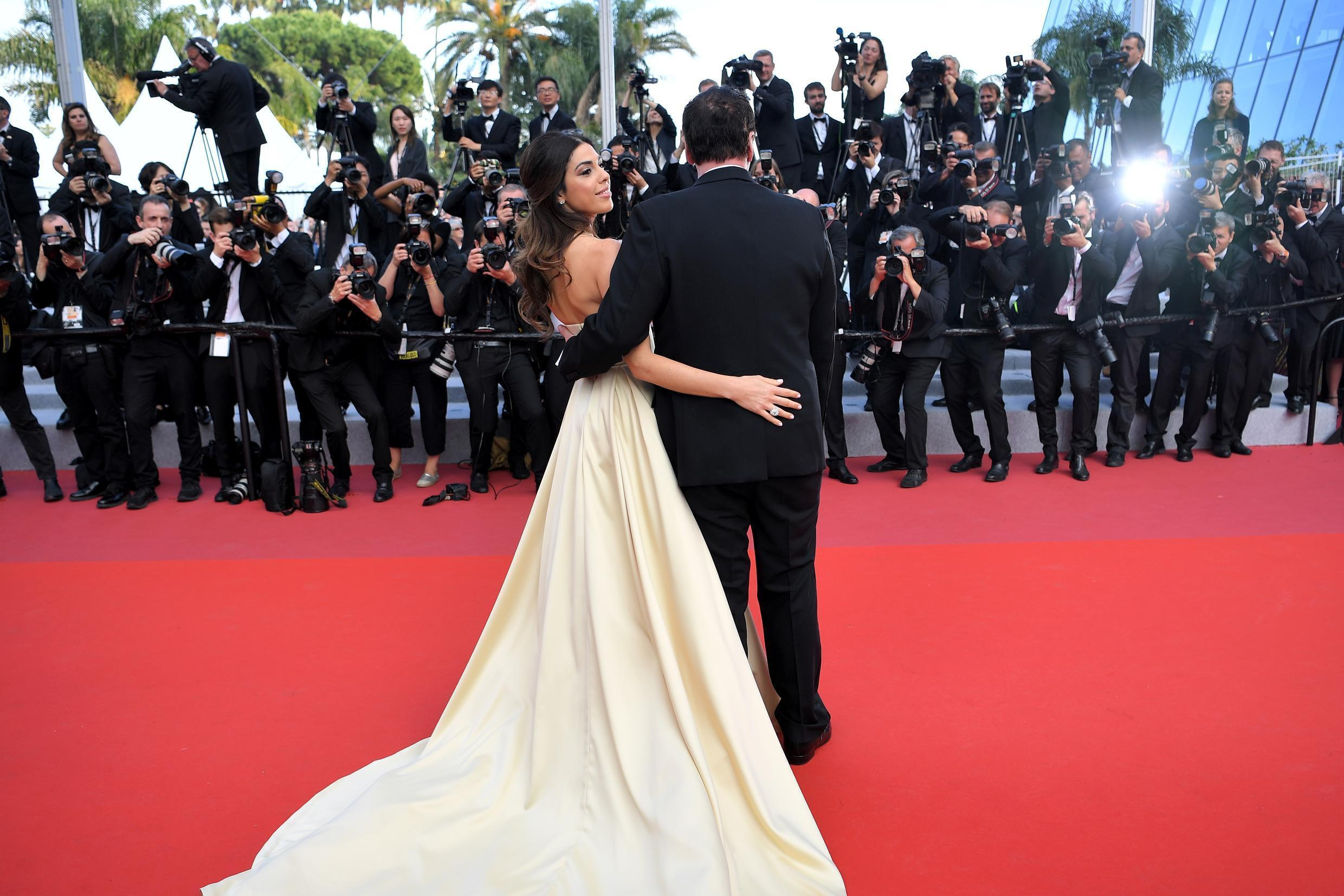 """Israeli singer Daniella Pick and her huband US film director Quentin Tarantino arrive for the screening of the film """"The Specials (Hors Normes)"""" at the 72nd edition of the Cannes Film Festival in Cannes, southern France, on May 25, 2019."""