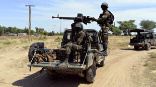 Cameroonian soldiers patrol Amchide on November 12, 2014, near the Nigerian border, after Boko Haram militants raided the city and forced residents to flee