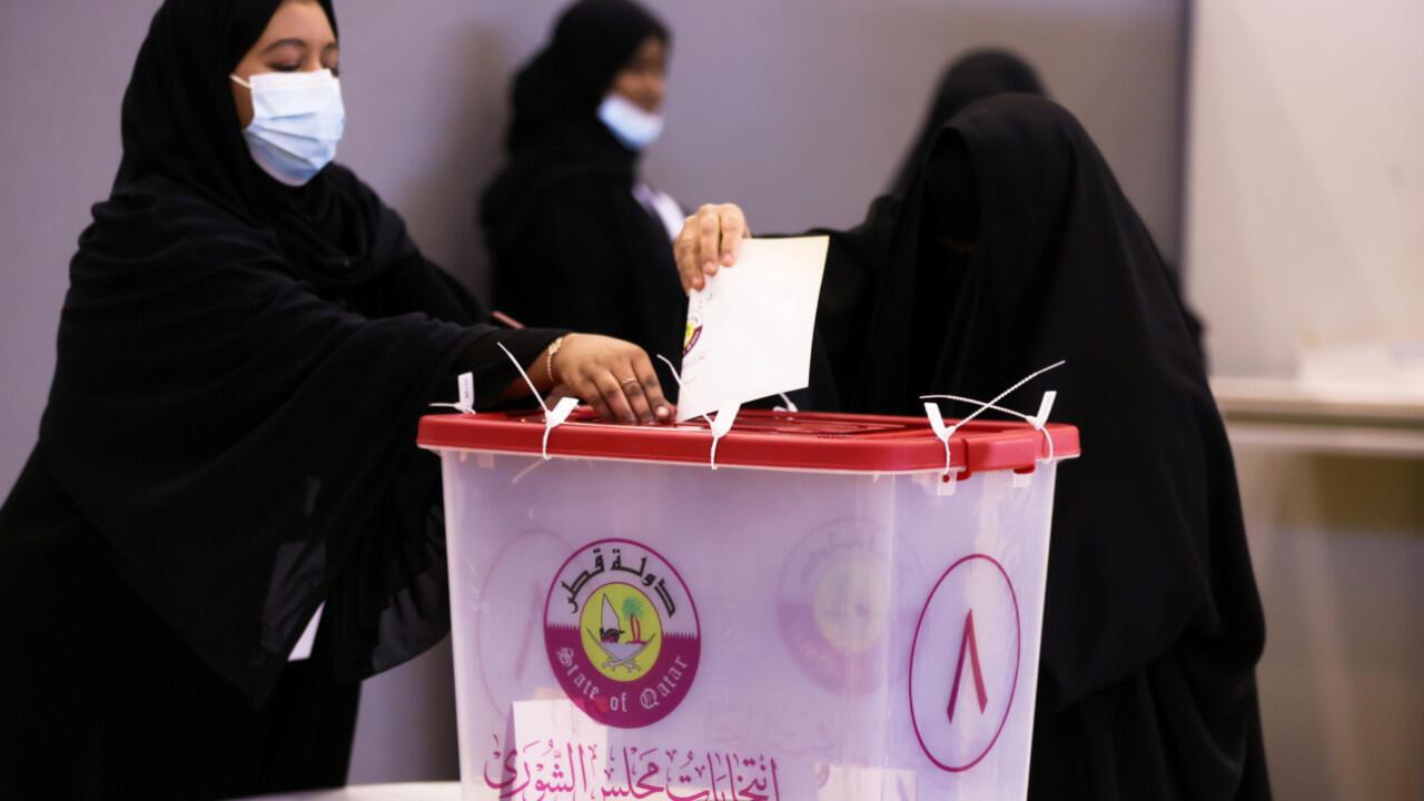 2021-10-03T053515Z_1374026983_RC252Q9U70NX_RTRMADP_3_QATAR-ELECTION-WOMEN