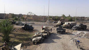 Abandoned vehicles Iraqi military vehicles in Ramadi on May 17, 2015