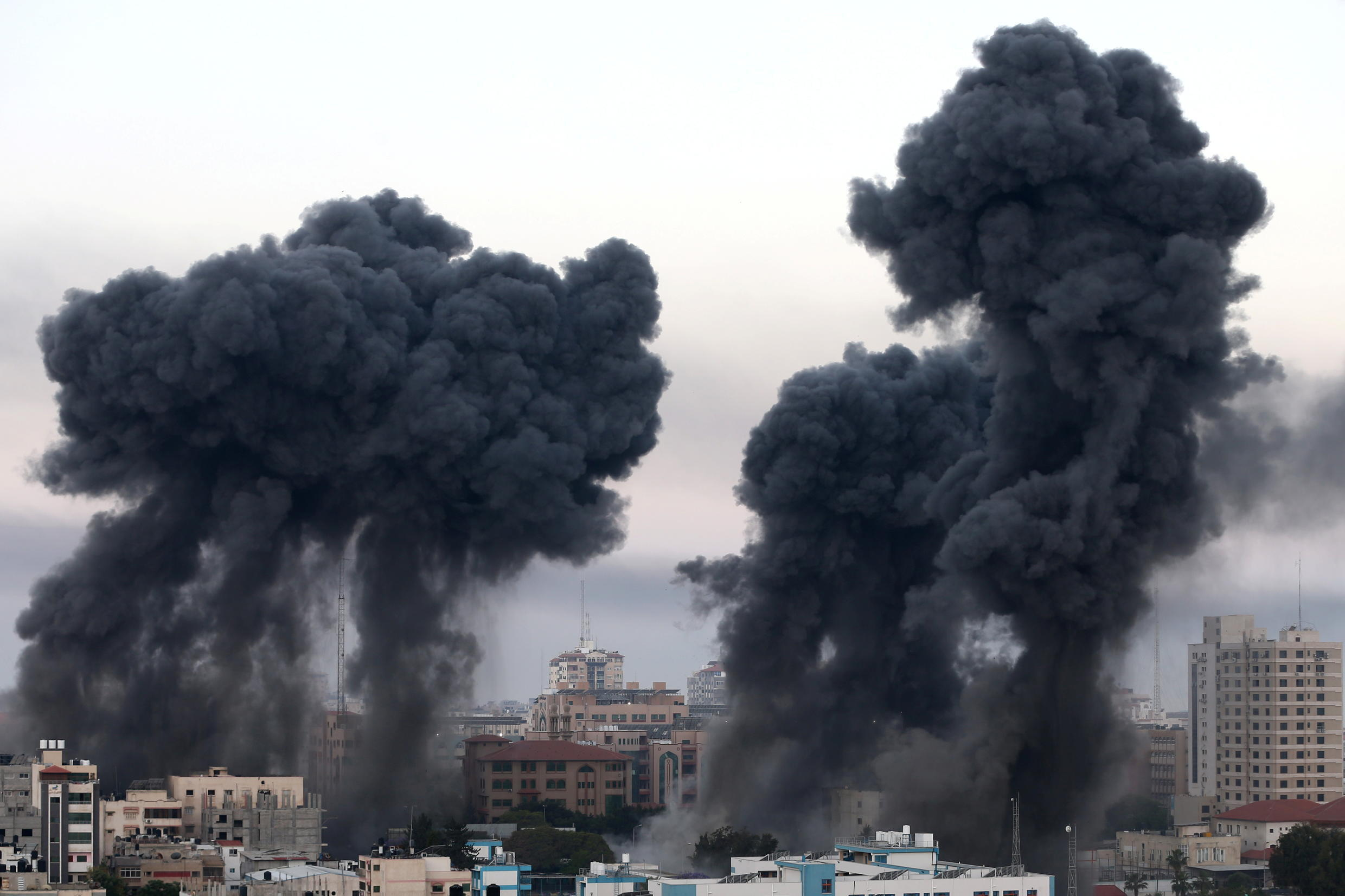 Plumes of smoke rise during Israeli air strikes amid a flare-up of Israeli-Palestinian violence, in Gaza May 12, 2021.