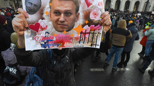 Russians rally for the release of jailed opposition leader Alexei Navalny who was arrested last month after returning to Russia from Germany where doctors treated him for poisoning by the Soviet-era nerve agent Novichok