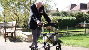Retired British Army Captain Tom Moore, 99, walks to raise money for health workers, by attempting to walk the length of his garden one hundred times before his 100th birthday this month as the spread of coronavirus disease (COVID-19) continues, Marston Moretaine, Britain, April 15, 2020