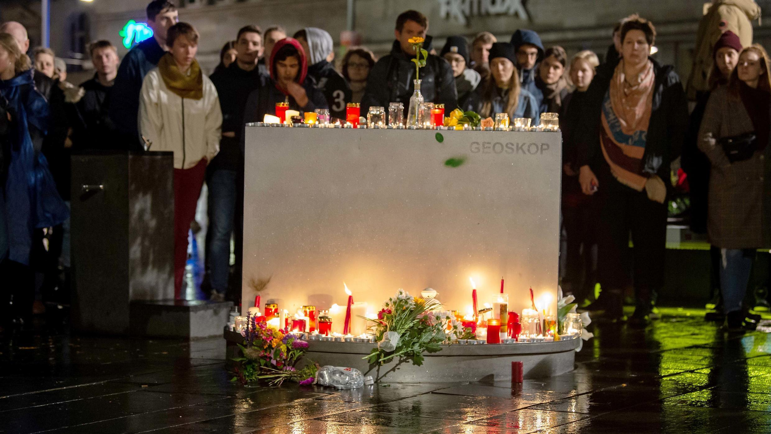 People leave candles and flowers at a vigil at the Marktplatz in Halle an der Saale, eastern Germany, on October 9, 2019.