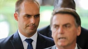 Eduardo Bolsonaro (L) is currently a member of the Brazilian parliament and accompanied his father to a private meeting with Trump during a diplomatic visit to Washington in March