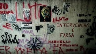 A mural in Rio de Janeiro covered in messages denouncing the murder of Marielle Franco