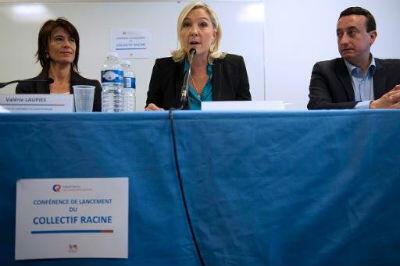 Marine Le Pen le 12 octobre entourée des fondateurs du Collectif Racine, Valérie Laupies (directrice et professeur des écoles en ZEP) et Alain Avello, professeur certifié de philosophie.