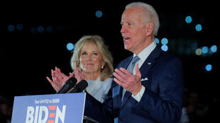 Democratic US presidential candidate and former Vice President Joe Biden speaks with his wife Jill at his side during a primary night speech at The National Constitution Center in Philadelphia, Pennsylvania, US, March 10, 2020.