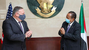 US Secretary of State Mike Pompeo (L) was in Khartoum in August for talks with Sudanese Prime Minister Abdalla Hamdok (R)