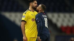 Dortmund's German midfielder Emre Can, seen here standing up to PSG's Neymar, is injured and will miss Saturday's match