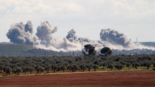 Smoke billows over the village of Qaminas, about 6 kilometres southeast of Idlib city in northwestern Syria, following reported Russian air strikes in northwestern Syria on March 1, 2020.